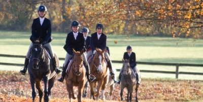 Girls hunting on horseback in the fall