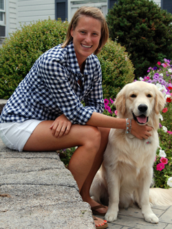 Coach with her dog. Golden Lab